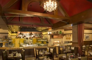 Inspired by farms in the Italian countryside, Trattoria al Forno at Disney's BoardWalk Resort features an open kitchen and family-friendly dining rooms. (Kent Phillips, photographer)