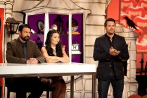 "Host Rossi Morreale, right, introduces the show, as Shinmin Li, middle, and Brian Kinney, left, sit at the judges' table before the start of the ""small scare"" challenge, as seen on Food Network's Halloween Wars, Season 5."