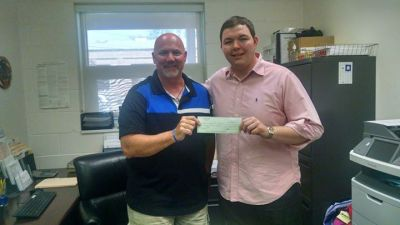 Human Needs Food Pantry Director Mike Bruno accepts donation from Chef James DeSisto (photo courtesy Human Needs Food Pantry)
