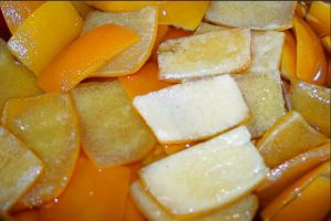 Orange Peel Being Prepared By Hand