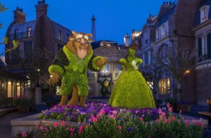 Belle and Beast in topiary form pose by a colorful garden at the France pavilion during the Epcot International Flower & Garden Festival