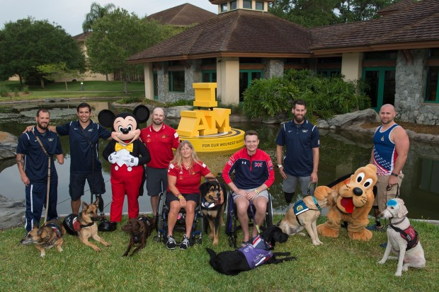 (May 12, 2016): Ahead of the Invictus Games Orlando 2016 closing ceremony, Mickey Mouse and Pluto celebrate service dogs and competitors, (L-R) Leonard Anderson with Azza, August O'Niell with Kai (USA), Luc Martin with Trail, Christine Gauthier with Battak (Canada), Jon Flint with Jester (Great Britain), Stefan LeRoy with Knoxville and Brett Parks with Freedom (USA), Thursday, May 12, 2016, at Walt Disney World Resort in Lake Buena Vista, Fla. Founded by Prince Harry, Invictus Games is the only adaptive sporting event for injured active duty and veteran service members. (David Roark, photographer)