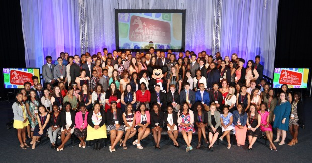 Disney Dreamers join (behind Mickey Mouse L-R) Mikki Taylor, editor-at-large for Essence Magazine, Michelle Ebanks, president of Essence Communications, Inc., radio and TV personality Steve Harvey, Tracey D. Powell, executive champion of Disney Dreamers Academy, and Mickey Mouse on March 6, 2016 to celebrate the commencement of the ninth Disney Dreamers Academy with Steve Harvey and Essence Magazine at Walt Disney World Resort in Lake Buena Vista, Fla. The annual event is a career-inspiration program for distinguished high school students from across the U.S. (Gregg Newton, photographer)