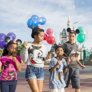 "Actors Marsai Martin, Yara Shahidi, Miles Brown and Marcus Scribner, from the cast of the ABC series ""black-ish,"" enjoy Mickey ice cream bars in front of Cinderella Castle at Magic Kingdom"